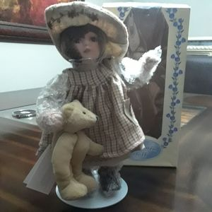NWOT In Box Porcelain Doll with stand